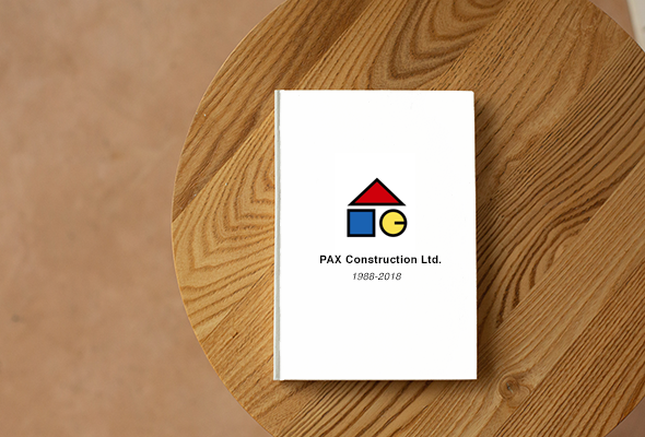 PAX Construction Corporate History Book on Coffee Table